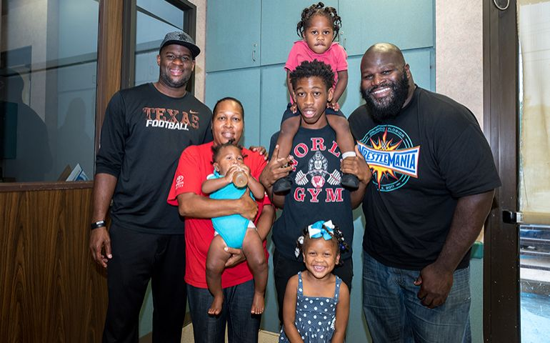 Hometown Football Star Vince Young, WWE's Mark Henry, Visit Harvey Survivors